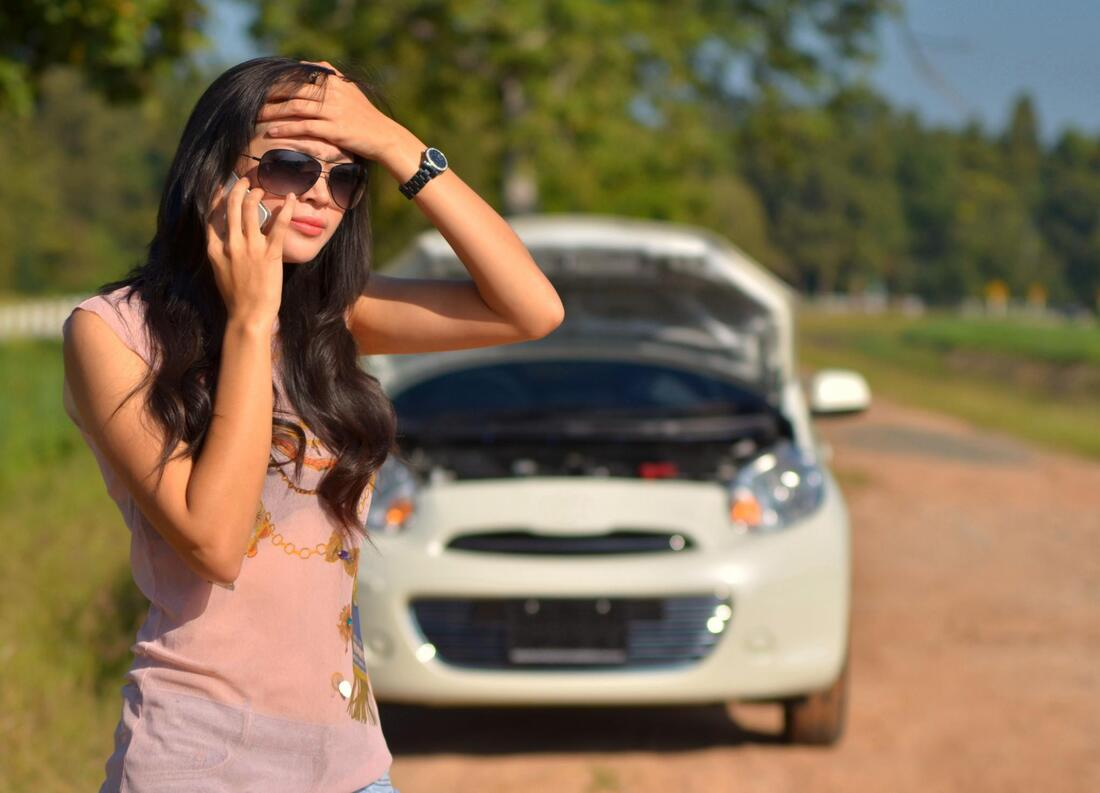 A girl seeking roadside assistance